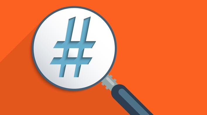 Hashtag under magnifier - illustration
